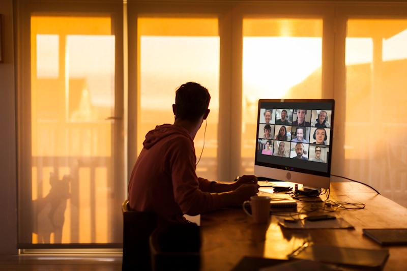 Young man distracted while on video call from his home during lockdown (Photo: Alistair Berg via Getty Images)