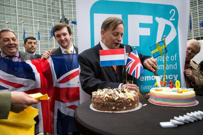 UK Independence Party (UKIP) members celebrate the historic Brexit day with cake