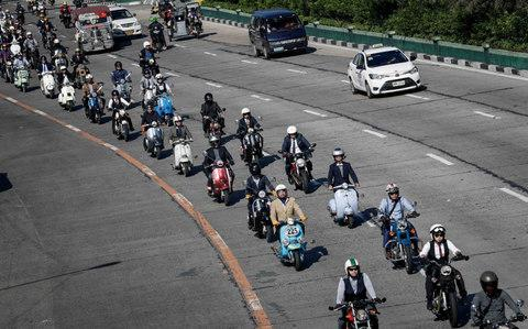The ride takes place all around the world. Here, distinguished gents take to the roads in Manila, Philippines