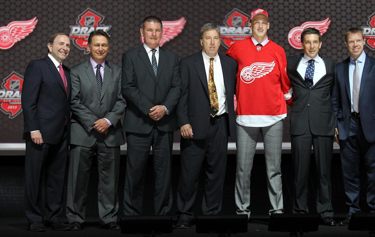 Jun 30, 2013; Newark, NJ, USA; Anthony Mantha poses for a photo with team officials after being introduced as the number twenty overall pick to the Detroit Red Wings during the 2013 NHL Draft at the Prudential Center. (Ed Mulholland-USA TODAY Sports)