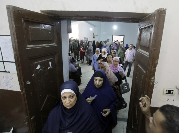 Egyptian women line up at a polling station in Cairo, Egypt, Thursday, May 24, 2012. In a wide-open race that will define the nation's future political course, Egyptians voted Thursday on the second day of a landmark presidential election that will produce a successor to longtime authoritarian ruler Hosni Mubarak. (AP Photo/Amr Nabil)