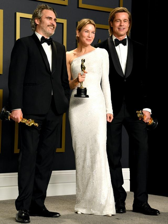 Joaquin Phoenix, winner of the best actor Oscar, Renee Zellweger, winner of best actress, and Brad Pitt, winner of best supporting actor in the press room at the 92nd Academy Awards held at the Dolby Theatre in Hollywood, Los Angeles