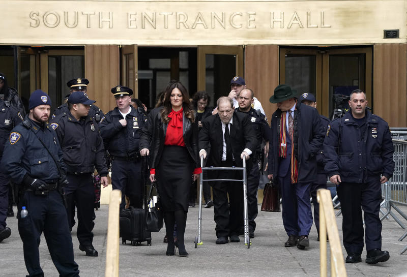 Harvey Weinstein and his solicitor Donna Rotunno go out of New York Criminal Court after the fifth day of a trial in New York City. (Photo: John Lamparski / Echoes Wire / Barcroft Media through Getty Images)