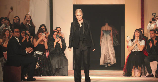 Designer Maria Grazia Chiuri accepts applause during a show featuring models wearing creations for the Dior Spring/Summer 2019 Haute Couture fashion collection presented in Dubai, United Arab Emirates, Monday, March 18, 2019. (AP Photo/Jon Gambrell)