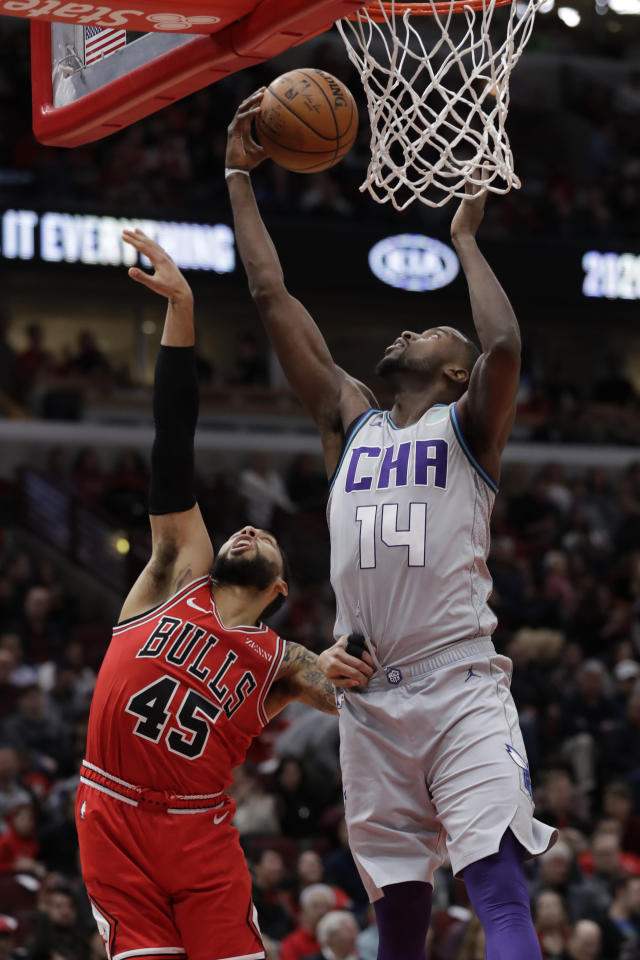 Charlotte Hornets forward Michael Kidd-Gilchrist, right, shoots against Chicago Bulls guard Denzel Valentine during the first half of an NBA basketball game Friday, Dec. 13, 2019, in Chicago. (AP Photo/Nam Y. Huh)