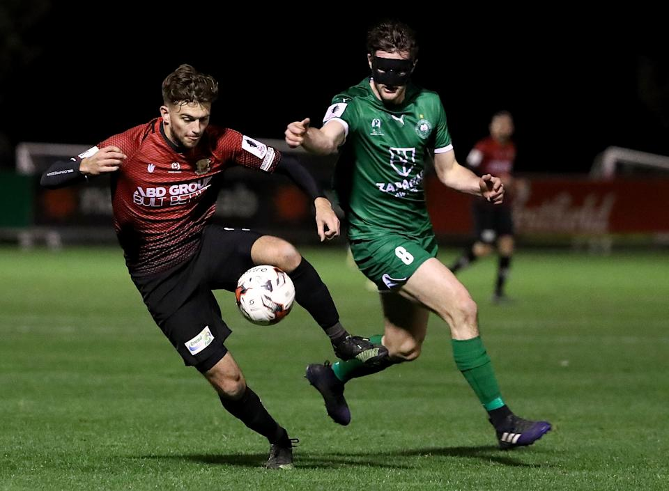 MELBOURNE, AUSTRALIA - AUGUST 09: Daniel Clark of Hume City is chased by Andy Brennan of Bentleigh Greens during the FFA Cup round of 32 match between Hume City FC and Bentleigh Greens at John Iilhan Memorial Reserve on August 9, 2017 in Melbourne, Australia.  (Photo by Robert Cianflone/Getty Images)