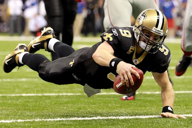 NEW ORLEANS, LA - NOVEMBER 28: Drew Brees #9 of the New Orleans Saints dives into the endzone for a touchdown against the New York Giants at Mercedes-Benz Superdome on November 28, 2011 in New Orleans, Louisiana. (Photo by Ronald Martinez/Getty Images)