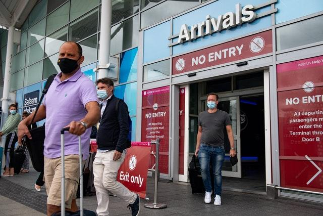 Passengers flying from Malaga arrive at Birmingham Airport