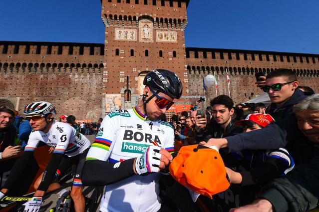 Peter Sagan signs authographs at the start of the 110th edition of the Milano-Sanremo cycling race in Milan, Italy, Saturday, March 23, 2019. Sagan finished fourth. (Dario Belinghieri/ANSA via AP)