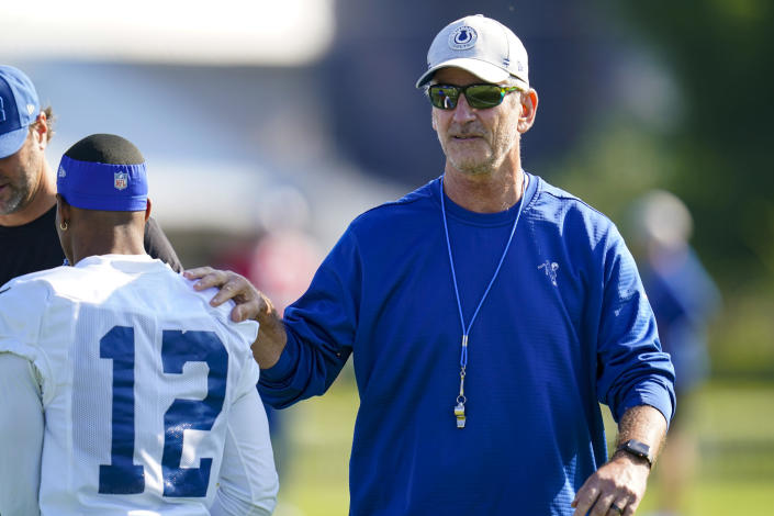 Indianapolis Colts head coach Frank Reich greets wide receiver DeMichael Harris before the start of practice at the NFL team's football training camp in Westfield, Ind., Monday, Aug. 2, 2021. Reich returned to practice following his quarantine period and two negative tests after a positive test for COVID-19. (AP Photo/Michael Conroy)
