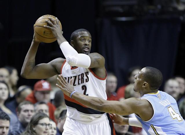 Portland Trail Blazers guard Wesley Matthews, left, looks to pass against Denver Nuggets guard Randy Foye during the first half of an NBA basketball game in Portland, Ore., Thursday, Jan. 23, 2014. (AP Photo/Don Ryan)