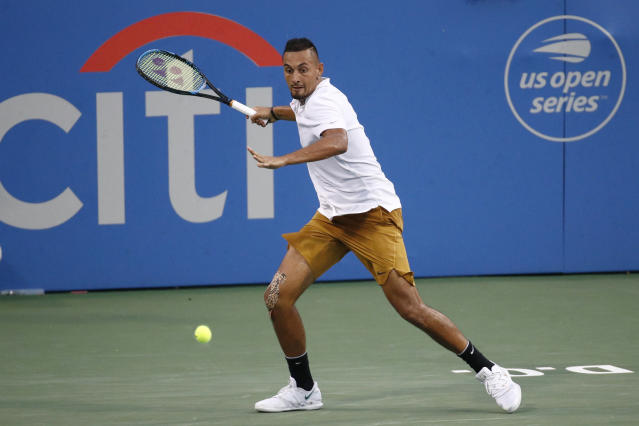 Nick Kyrgios, of Australia, returns the ball to Stefanos Tsitsipas, of Greece, during a semifinal at the Citi Open tennis tournament Saturday, Aug. 3, 2019, in Washington. (AP Photo/Patrick Semansky)