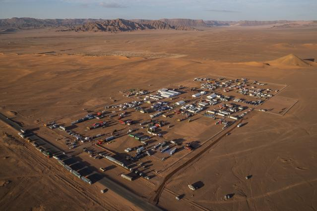 In this Wednesday, Jan. 8, 2020 photo, an overview of the Dakar rally bivouac in Al Ula, in Saudi Arabia. Formerly known as the Paris-Dakar Rally, the race was created by Thierry Sabine after he got lost in the Libyan desert in 1977. Until 2008, the rallies raced across Africa, but threats in Mauritania led organizers to cancel that year's event and move it to South America. It has now shifted to Saudi Arabia. The race started on Jan. 5 with 560 drivers and co-drivers, some on motorbikes, others in cars or in trucks. Only 41 are taking part in the Original category. (AP Photo/Bernat Armangue)