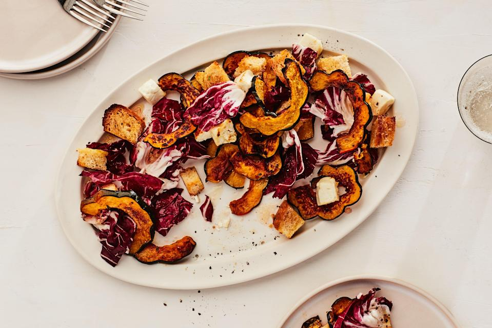 "Feta and bread get roasted alongside squash, then tossed with pleasantly bitter greens for a vegetarian dinner salad that's equal parts warm and cold, soft and crunchy, and sweet and savory. <a href=""https://www.epicurious.com/recipes/food/views/sheet-pan-roasted-squash-and-feta-salad?mbid=synd_yahoo_rss"" rel=""nofollow noopener"" target=""_blank"" data-ylk=""slk:See recipe."" class=""link rapid-noclick-resp"">See recipe.</a>"