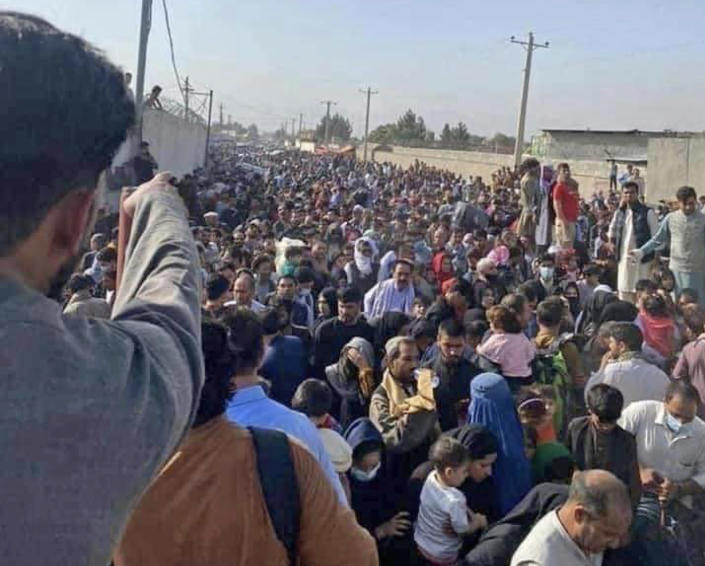 IMAGE: Afghans hoping to be evacuated gather at the airport in Kabul (Najeeb Rahimi)