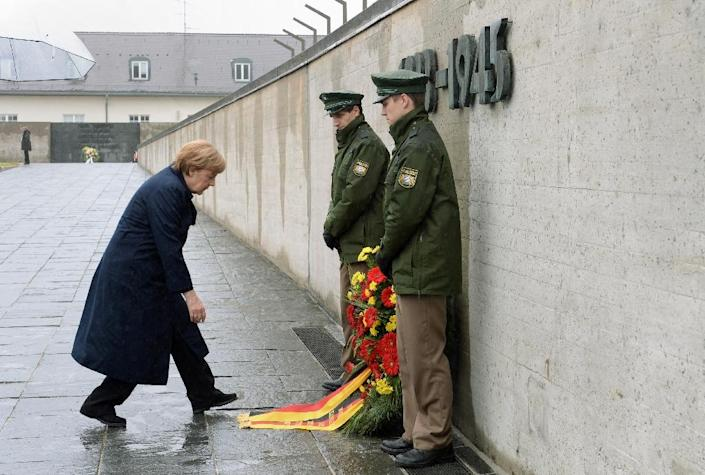 German Chancellor Angela Merkel at a wreath laid in her name in front of the International Memorial of former Nazi concentration camp of Dachau, southwest Germany, during a ceremony to mark 70 years since it was liberated by US forces on May 3, 2015 (AFP Photo/Christof Stache)