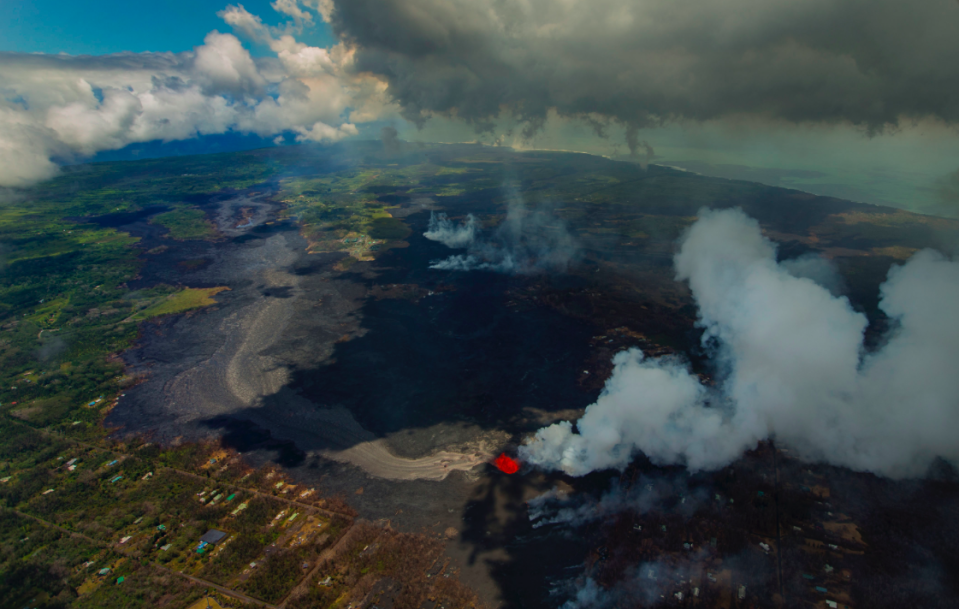 <em>New land has been created as a result of the volcano (PA)</em>