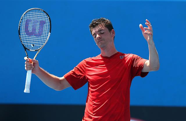 MELBOURNE, AUSTRALIA - JANUARY 14: Frank Dancevic of Canada reacts in his first round match against Benoit Paire of France during day two of the 2014 Australian Open at Melbourne Park on January 14, 2014 in Melbourne, Australia. (Photo by Robert Prezioso/Getty Images)