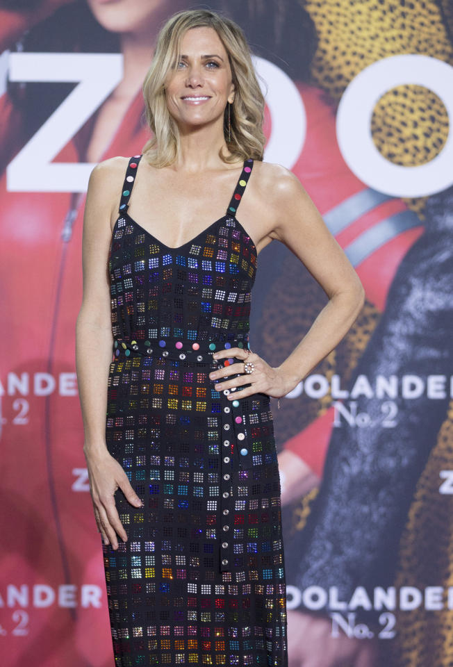 Actress Kristen Wiig poses for the media as she arrives for the German premiere of the movie 'Zoolander 2' in Berlin, Germany, Tuesday, Feb. 2, 2016. (AP Photo/Axel Schmidt)