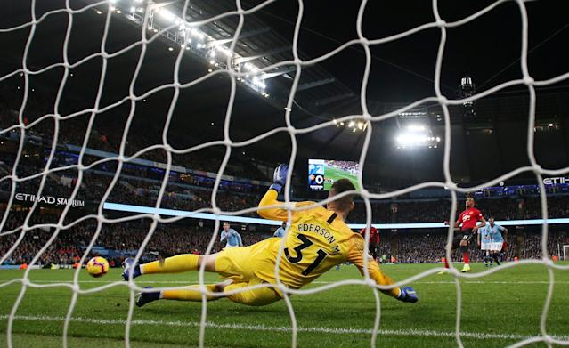 """Soccer Football - Premier League - Manchester City v Manchester United - Etihad Stadium, Manchester, Britain - November 11, 2018 Manchester United's Anthony Martial scores their first goal from the penalty spot Action Images via Reuters/Jason Cairnduff EDITORIAL USE ONLY. No use with unauthorized audio, video, data, fixture lists, club/league logos or """"live"""" services. Online in-match use limited to 75 images, no video emulation. No use in betting, games or single club/league/player publications. Please contact your account representative for further details."""