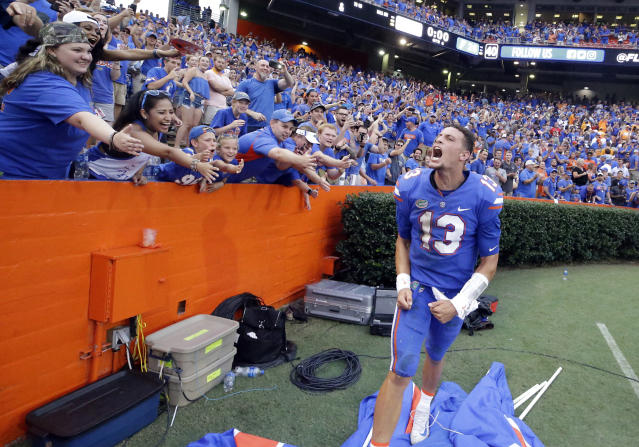 Florida quarterback Feleipe Franks (13) celebrates with fans after he threw a 63-yard touchdown pass as time expired to defeat Tennessee 26-20 in an NCAA college football game, Saturday, Sept. 16, 2017, in Gainesville, Fla. Florida won 26-20. (AP Photo/John Raoux)