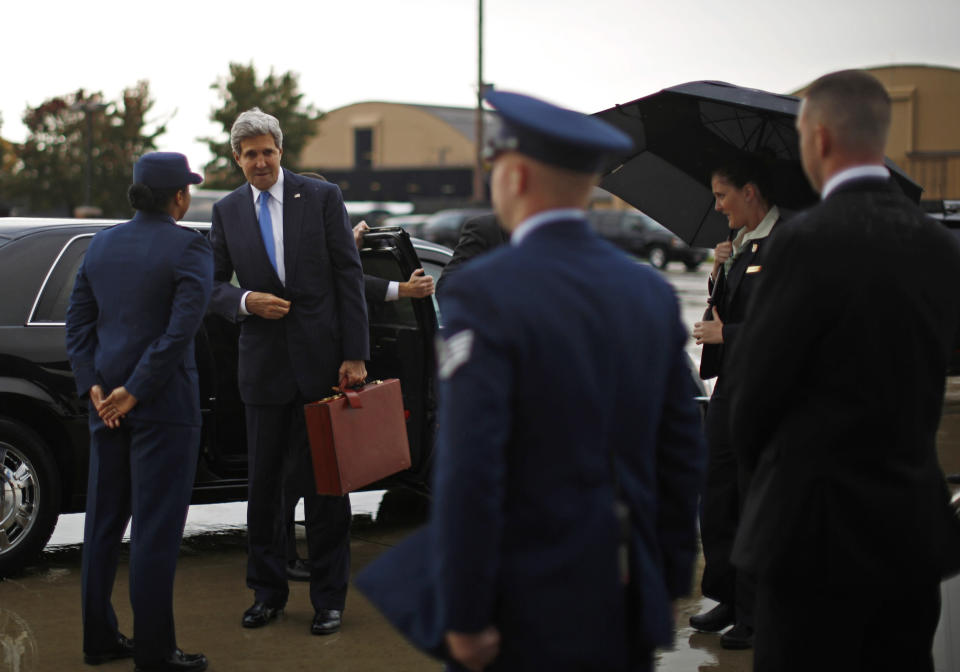 U.S. Secretary of State John Kerry prepares to board his aircraft at Andrews Air Force Base near Washington, Nov. 2, 2013. Kerry is in Cairo pressing for reforms during the highest-level American visit to Egypt since the ouster of the country's first democratically elected president. The Egyptian military's removal of Mohammed Morsi in July led the U.S. to suspend hundreds of millions of dollars in aid. It seems the State Department expected a frosty reception for Kerry ahead of Monday's scheduled start of Morsi's trial on charges of inciting murder. (AP Photo/Jason Reed,Pool)