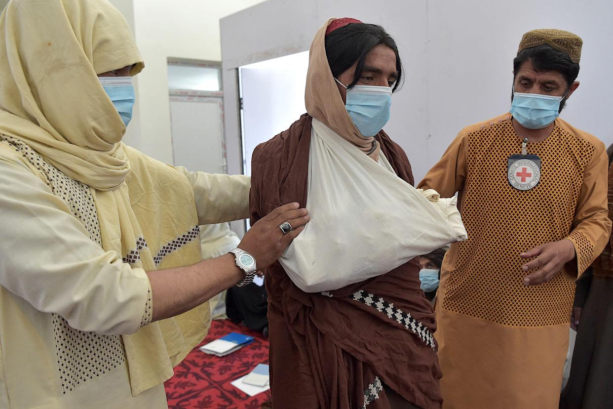 Taliban fighters participate in a first-aid training class