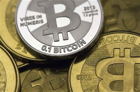 Some of Bitcoin enthusiast Mike Caldwell's coins are pictured at his office in this file photo illustration in Sandy, Utah January 31, 2014. REUTERS/Jim Urquhart/Files REUTERS/Jim Urquhart