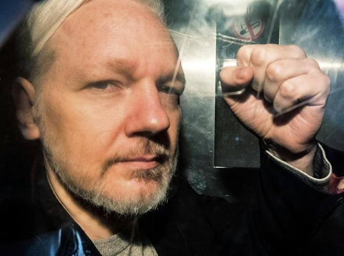 Assange gestures from the window of a prison van as he is driven into Southwark Crown Court in London on May 1 (AFP Photo/Daniel LEAL-OLIVAS)