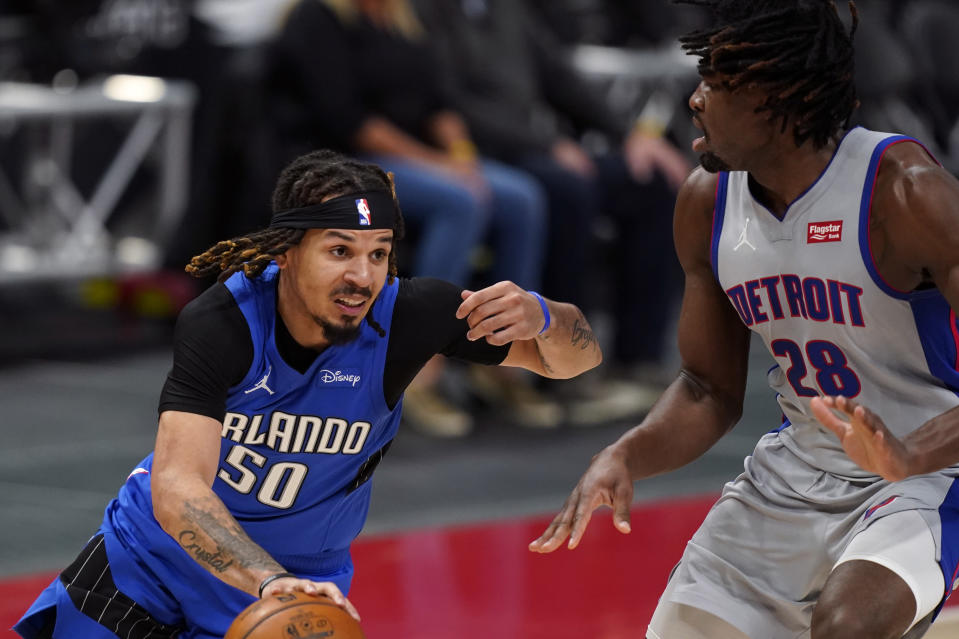 Orlando Magic guard Cole Anthony (50) drives as Detroit Pistons center Isaiah Stewart (28) defends during the second half of an NBA basketball game, Monday, May 3, 2021, in Detroit. (AP Photo/Carlos Osorio)
