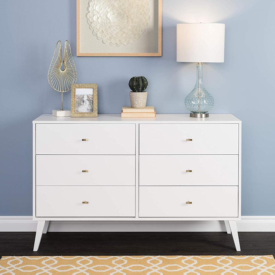 """<p>You can fit so much in this <a href=""""https://www.popsugar.com/buy/Prepac%20Milo%20Mid%20Century%20Modern%206%20Drawer%20Double%20Dresser-465711?p_name=Prepac%20Milo%20Mid%20Century%20Modern%206%20Drawer%20Double%20Dresser&retailer=amazon.com&price=291&evar1=casa%3Aus&evar9=46356293&evar98=https%3A%2F%2Fwww.popsugar.com%2Fhome%2Fphoto-gallery%2F46356293%2Fimage%2F46356612%2FPrepac-Milo-Mid-Century-Modern-6-Drawer-Double-Dresser&list1=amazon%2Cfurniture%2Cbedrooms%2Cshoppping%2Chome%20shopping&prop13=mobile&pdata=1"""" rel=""""nofollow"""" data-shoppable-link=""""1"""" target=""""_blank"""">Prepac Milo Mid Century Modern 6 Drawer Double Dresser</a> ($291).</p>"""