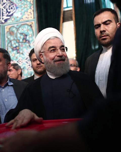 Iranian President Hassan Rouhani, who won a resounding re-election victory, casts his vote in Tehran on May 19, 2017 (AFP Photo/Behrouz MEHRI)