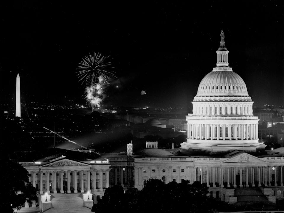 Rockets burst into the sky during traditional Fourth of July fireworks celebrating the 185th anniversary of Independence Day in Washington, DC, on July 4, 1961.