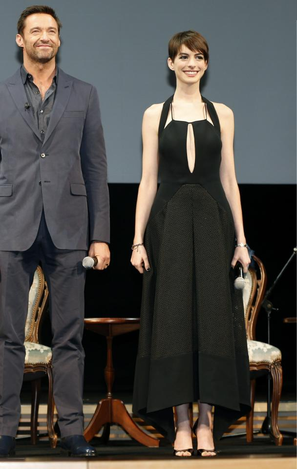 "Actor Hugh Jackman, left, and actress Anne Hathaway pose for photographers during a promotional event for their film ""Les Miserables"" in Tokyo, Wednesday, Nov. 28, 2012. (AP Photo/Shizuo Kambayashi)"