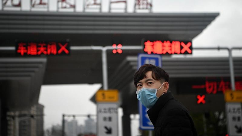Confusion as small Chinese city in coronavirus zone eases lockdown