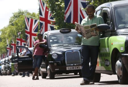 Taxis block the Mall in central London June 11, 2014. REUTERS/Luke MacGregor