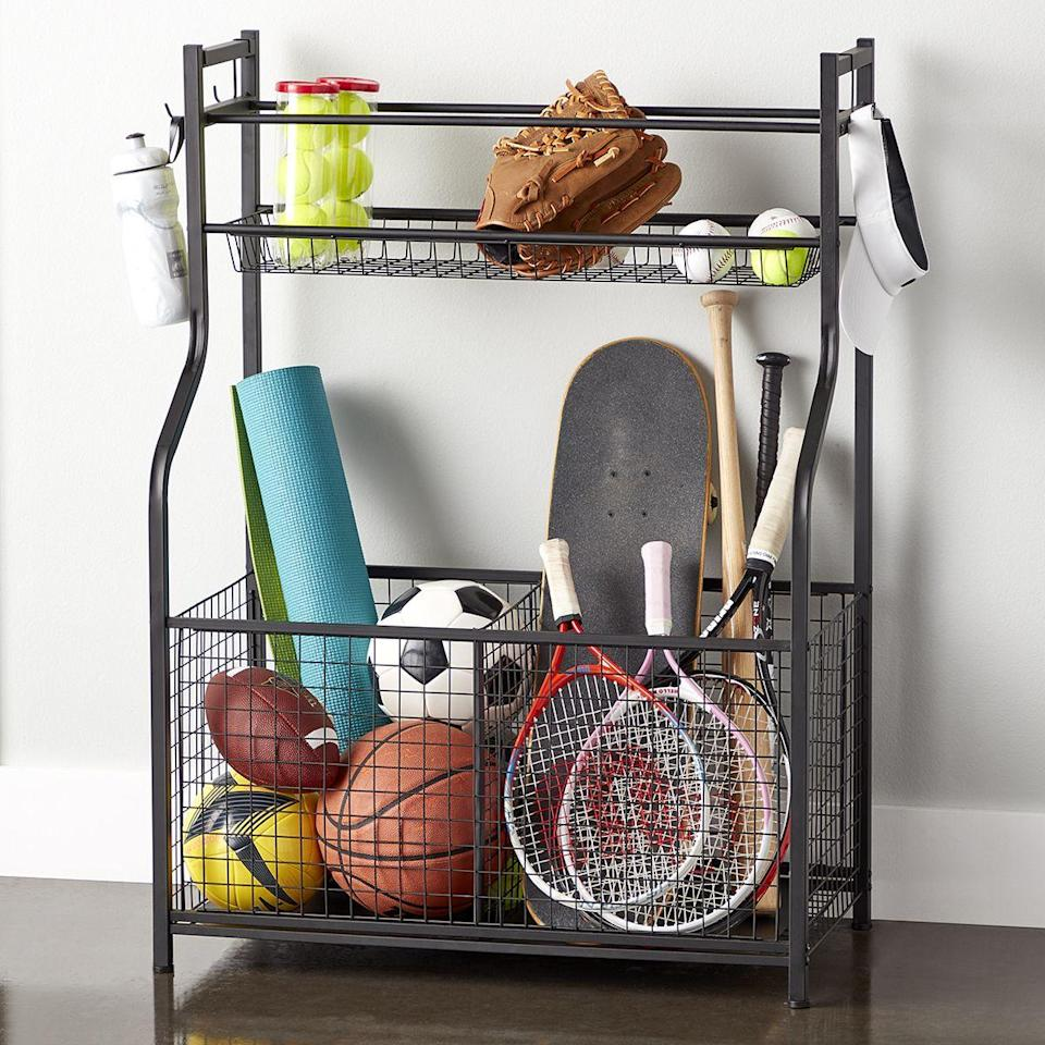 """<p><strong>Container Store</strong></p><p>containerstore.com</p><p><strong>$79.99</strong></p><p><a href=""""https://go.redirectingat.com?id=74968X1596630&url=https%3A%2F%2Fwww.containerstore.com%2Fs%2Fgarage%2Fsports-bike-storage%2Fheavy-duty-sports-storage-rack%2F12d%3FproductId%3D11008418&sref=https%3A%2F%2Fwww.popularmechanics.com%2Fhome%2Fg37190947%2Fbest-garage-storage-ideas%2F"""" rel=""""nofollow noopener"""" target=""""_blank"""" data-ylk=""""slk:Shop Now"""" class=""""link rapid-noclick-resp"""">Shop Now</a></p><p>From gloves to balls, this storage rack was specifically made for sports gear. You'll be happy with the steel frame featuring two wire-grid bins, a basket for larger balls, a basket for smaller balls, and hooks. Each hook can hold up to 6.6 pounds, while the upper basket and lower basket can hold 30 and 44 pounds respectively. </p>"""
