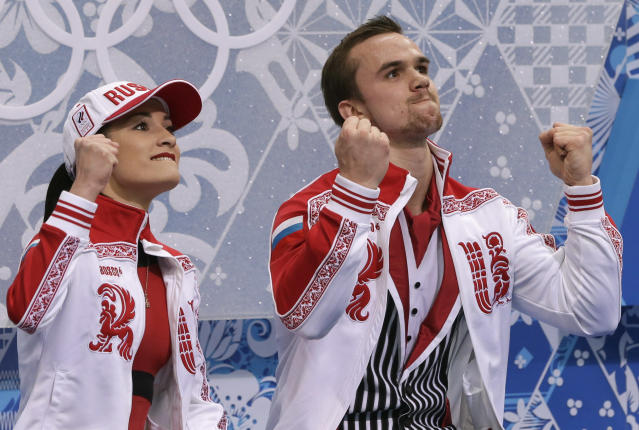 Ksenia Stolbova and Fedor Klimov of Russia react as they wait in the results area after competing in the pairs free skate figure skating competition at the Iceberg Skating Palace during the 2014 Winter Olympics, Wednesday, Feb. 12, 2014, in Sochi, Russia. (AP Photo/Darron Cummings)