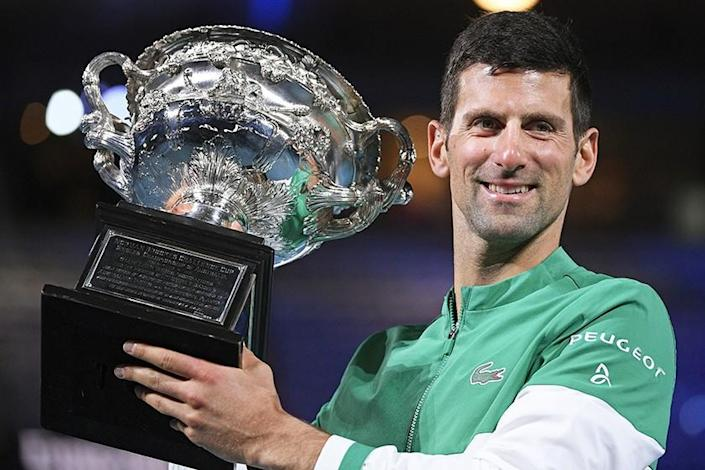 Serbia's Novak Djokovic with the Norman Brookes Challenge Cup after winning the Australian Open on Sunday.