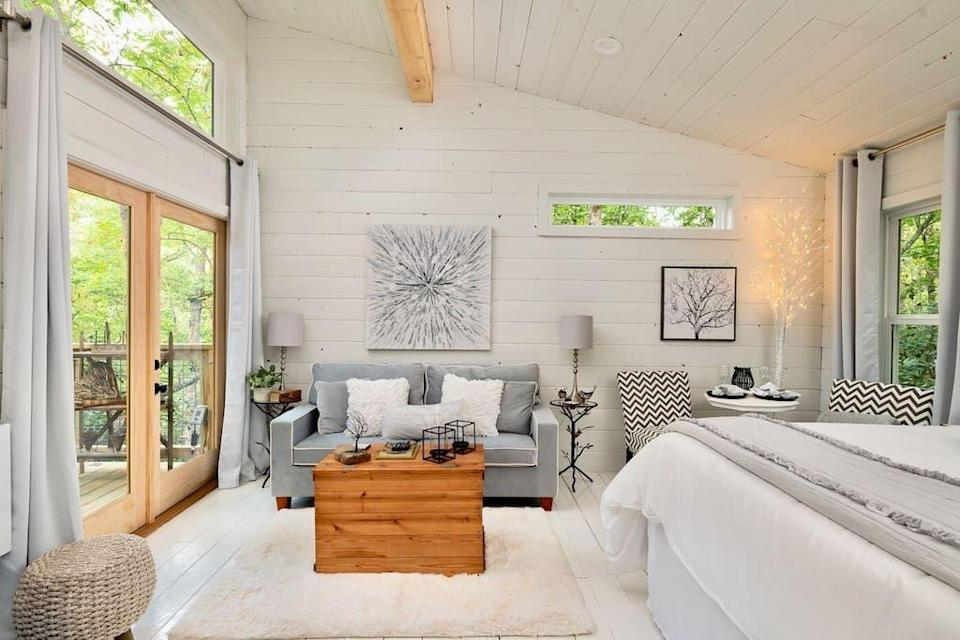 """<p>airbnb.com</p><p><strong>$293.00</strong></p><p><a href=""""https://www.airbnb.com/rooms/37567682"""" rel=""""nofollow noopener"""" target=""""_blank"""" data-ylk=""""slk:BOOK NOW"""" class=""""link rapid-noclick-resp"""">BOOK NOW</a></p><p>Equidistant from Asheville and Black Mountain this luxe treehouse offers a kitchen, hot tub, and bathroom nestled amongst the hardwood forest.</p>"""