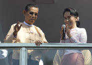 FILE - In this Nov. 9, 2015, file photo, then leader of Myanmar's National League for Democracy party, Aung San Suu Kyi, delivers a speech with party patron Tin Oo from a balcony of her party's headquarters in Yangon, Myanmar. Myanmar's military has taken control of the country under a one-year state of emergency and reports say State Counsellor Aung San Suu Kyi and other government leaders have been detained. (AP Photo/Mark Baker, File)