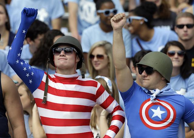 North Carolina fans cheer prior to an NCAA college football game against East Carolina in Chapel Hill, N.C., Saturday, Sept. 28, 2013. (AP Photo/Gerry Broome)