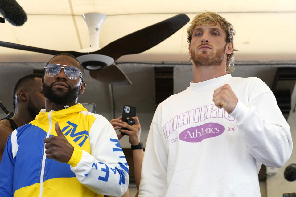 Floyd Mayweather, left, and Logan Paul, right, pose for a photograph during a press event, Thursday, June 3, 2021, in Miami Beach, Fla. Mayweather will fight Paul in an exhibition boxing match at the Hard Rock Stadium in Miami Gardens, Fla. Sunday. (AP Photo/Lynne Sladky)