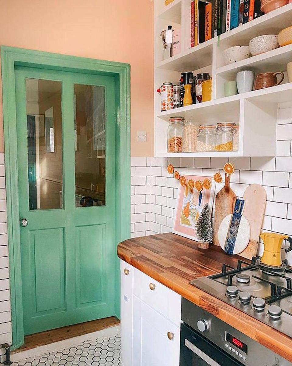 Clean simple décor choices such as tiling and pastel colours help to make this galley kitchen feel spacious (@charminglifebyjess)