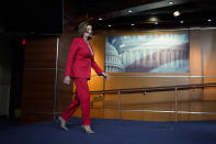 House Speaker Nancy Pelosi of Calif., arrives to speak to the media, Wednesday Dec. 30, 2020, on Capitol Hill in Washington. (AP Photo/Jacquelyn Martin)