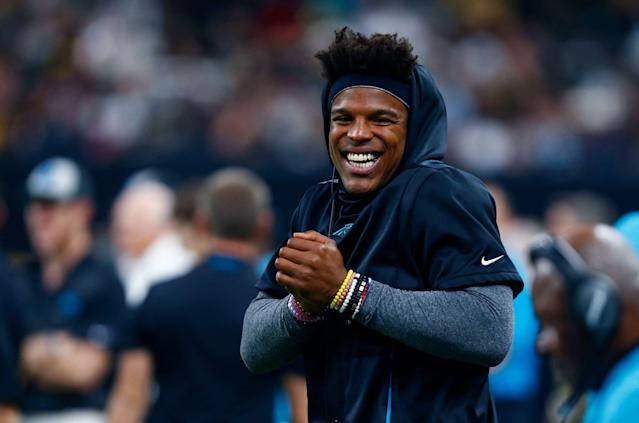 Carolina Panthers quarterback Cam Newton was happy the team drafted another quarterback. (AP)