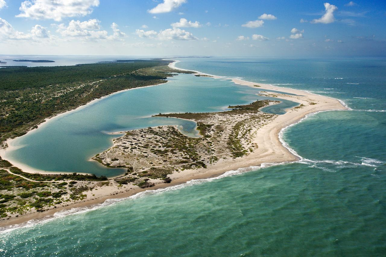 """<p>Only accessible by boat, the trip to <a rel=""""nofollow"""" href=""""https://www.floridastateparks.org/park/Cayo-Costa"""">Cayo Costa State Park</a>—by ferry from Captiva Island, Punta Gorda, Boca Grande, and Pine Island—is part of the adventure. There's a good chance you'll spot manatees or porpoises in their natural habitat, as you set your eyes on the quiet barrier island. With nine miles of beautiful beaches, mangrove swamps, and acres of pine forests, there's no shortage of swimming, snorkeling, fishing, shelling, and kayaking (rentals are available from the ranger station). Overnight options are charmingly rustic: Choose from one of the 12 one-room cabins, which sleep six each (some have small screened porches); 30 tent camping sites; and slips for private boats. </p>"""