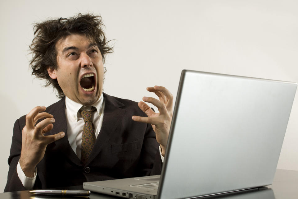 a business man screaming isolated on white. bad news?