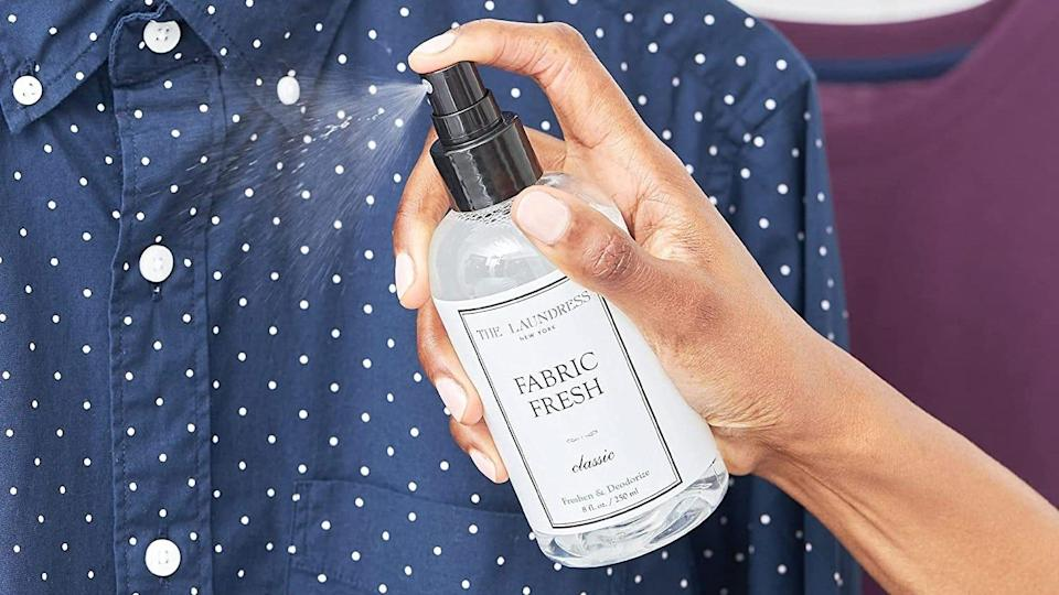 This spray refreshes and deodorizes your clothing, letting you wear it again.