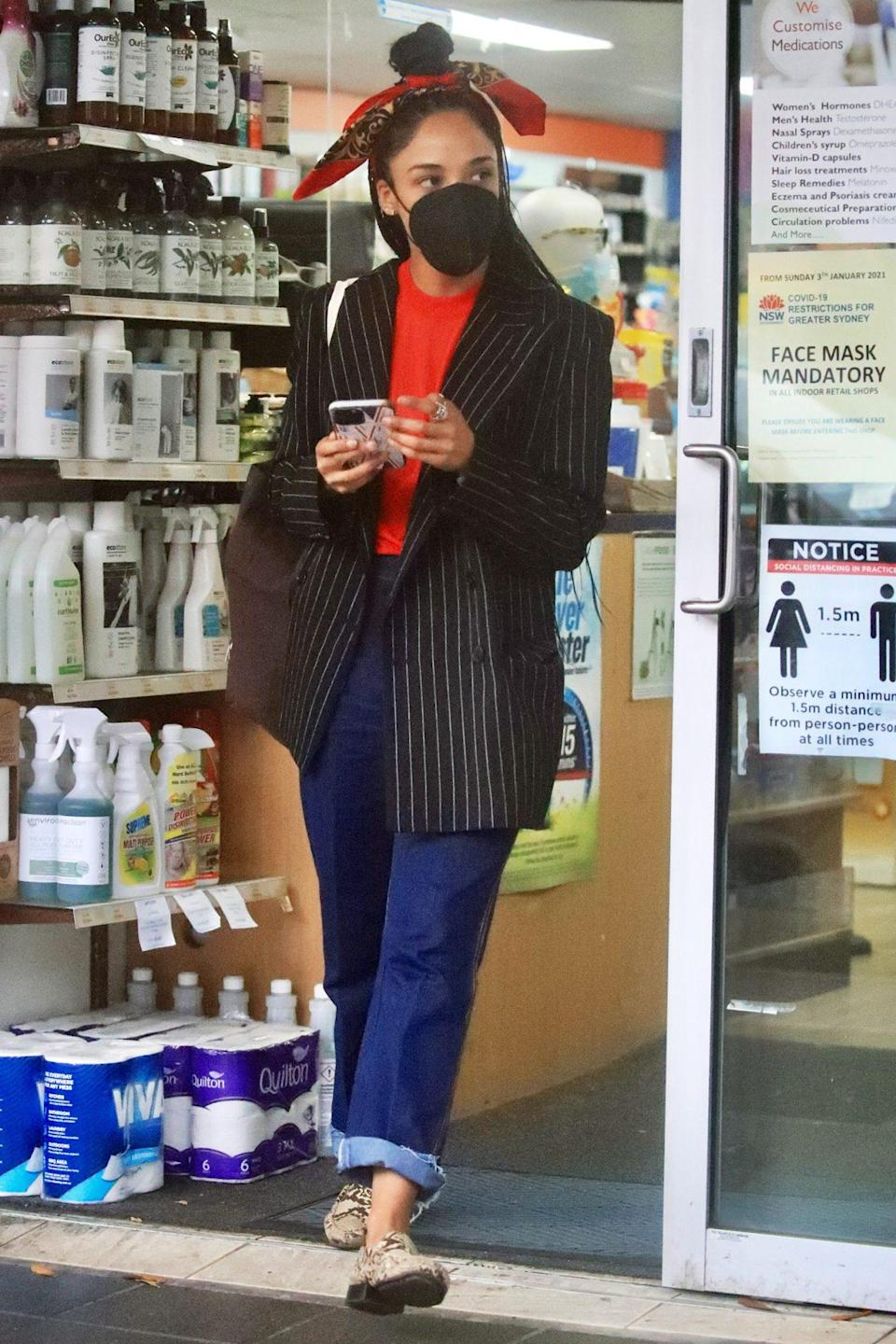 <p>Tessa Thompson looks chic in jeans and a blazer as she stops at a pharmacy in Bondi Beach, Australia on Wednesday. </p>